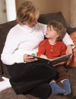 mother and son reading a book tigether